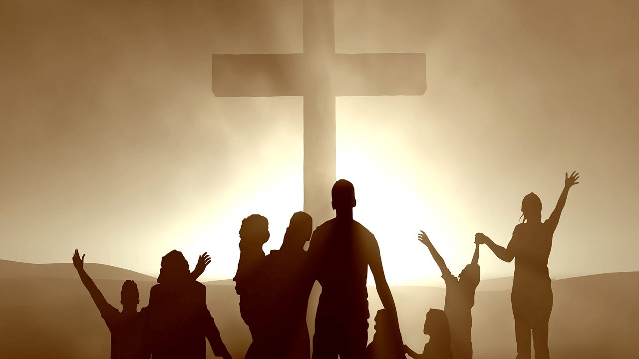 Christ in business Photo of cross with people